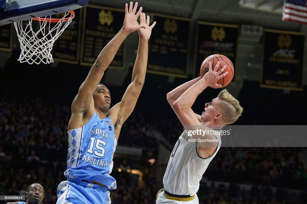 North Carolina Tar Heels forward Garrison Brooks (15) attempts to block a shot from Notre Dame Fighting Irish guard Rex Pflueger (0) during the college basketball game between the North Carolina Tar Heels and the Notre Dame Fighting Irish on January 13, 2018, at the Purcell Pavilion in South Bend, IN. The North Carolina Tar Heels defeated the Notre Dame Fighting Irish by the score of 69 to 68.