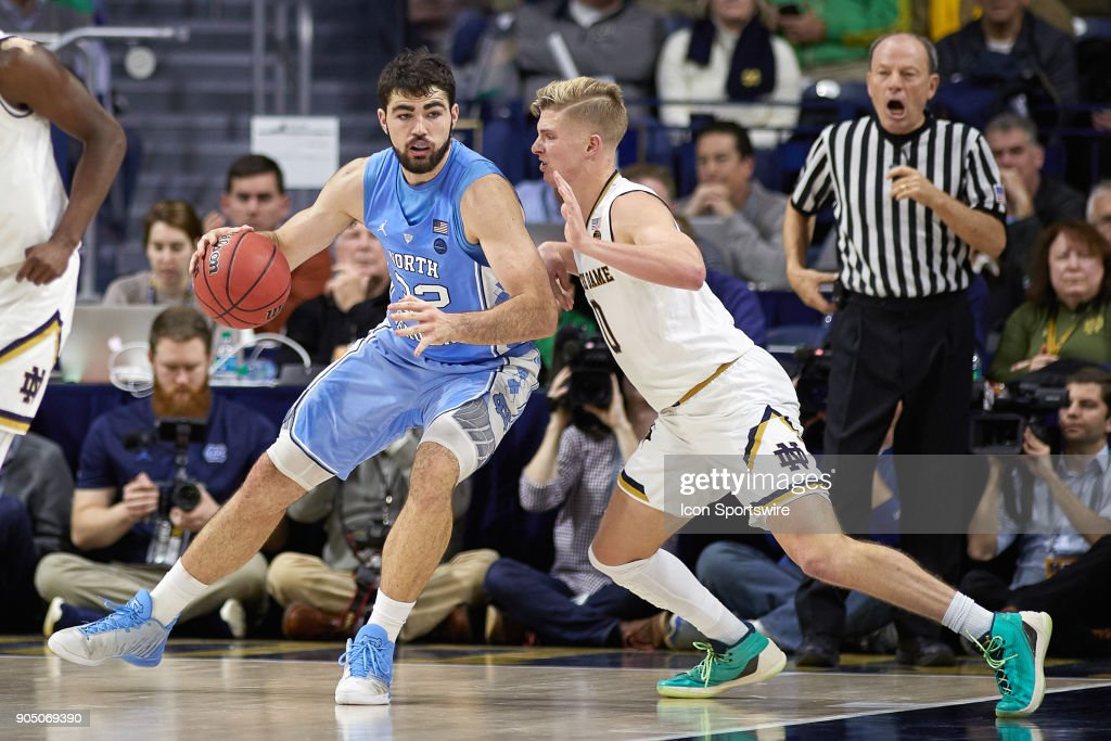 North Carolina Tar Heels forward Luke Maye (32) battles with Notre Dame Fighting Irish guard Rex Pflueger (0) during the college basketball game between the North Carolina Tar Heels and the Notre Dame Fighting Irish on January 13, 2018, at the Purcell Pavilion in South Bend, IN. The North Carolina Tar Heels defeated the Notre Dame Fighting Irish by the score of 69 to 68.