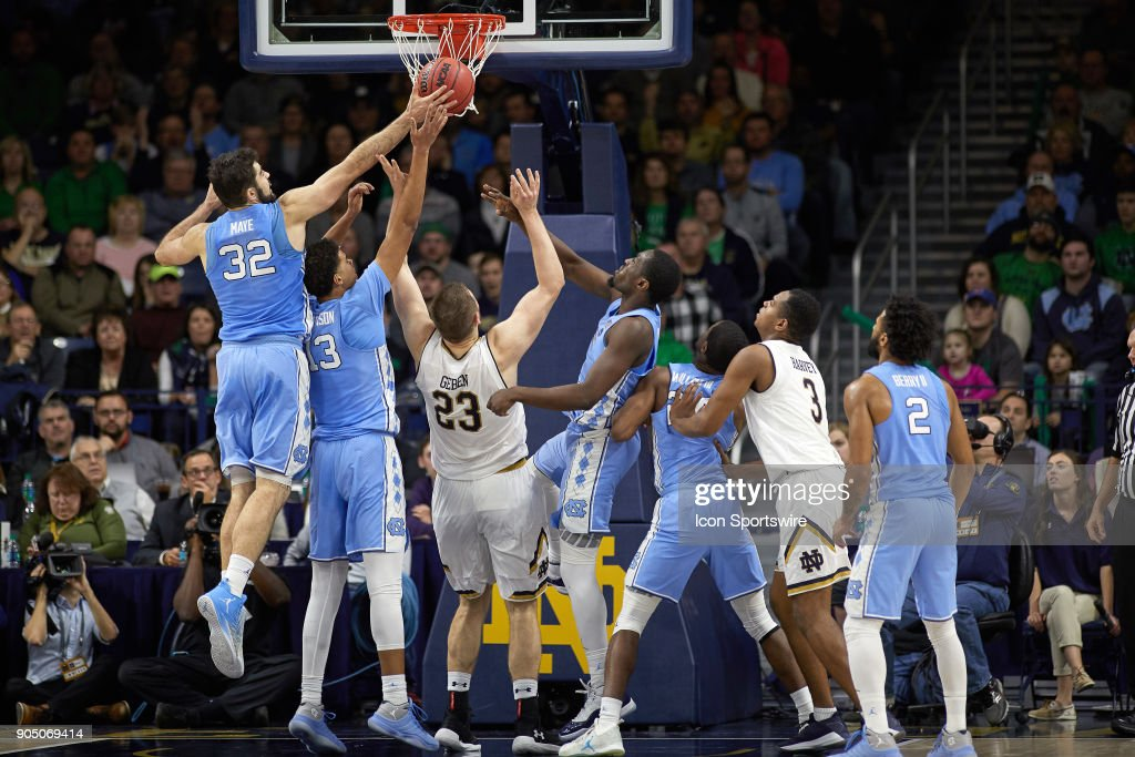 North Carolina Tar Heels forward Luke Maye (32), North Carolina Tar Heels guard Cameron Johnson (13), North Carolina Tar Heels forward Theo Pinson (1), North Carolina Tar Heels guard Kenny Williams (24) and North Carolina Tar Heels guard Joel Berry II (2) battle with Notre Dame Fighting Irish forward Martinas Geben (23) and Notre Dame Fighting Irish guard D.J. Harvey (3) for a rebound during the college basketball game between the North Carolina Tar Heels and the Notre Dame Fighting Irish on January 13, 2018, at the Purcell Pavilion in South Bend, IN. The North Carolina Tar Heels defeated the Notre Dame Fighting Irish by the score of 69 to 68.