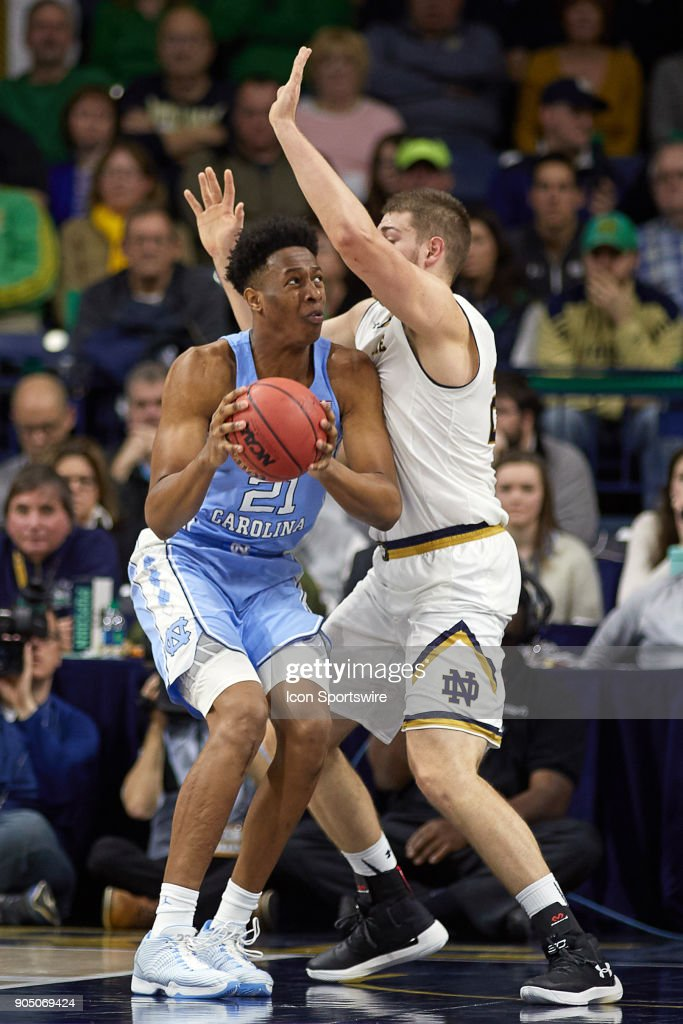 North Carolina Tar Heels forward Sterling Manley (21) battles with Notre Dame Fighting Irish forward Martinas Geben (23) during the college basketball game between the North Carolina Tar Heels and the Notre Dame Fighting Irish on January 13, 2018, at the Purcell Pavilion in South Bend, IN. The North Carolina Tar Heels defeated the Notre Dame Fighting Irish by the score of 69 to 68.