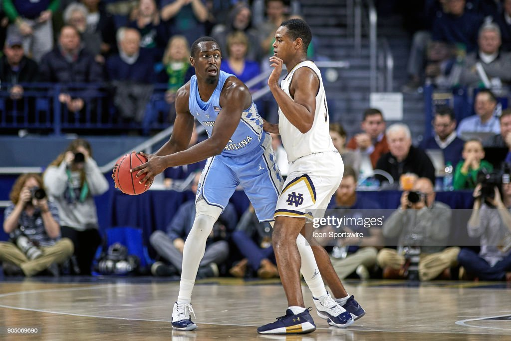 North Carolina Tar Heels forward Theo Pinson (1) battles with Notre Dame Fighting Irish guard D.J. Harvey (3) during the college basketball game between the North Carolina Tar Heels and the Notre Dame Fighting Irish on January 13, 2018, at the Purcell Pavilion in South Bend, IN. The North Carolina Tar Heels defeated the Notre Dame Fighting Irish by the score of 69 to 68.