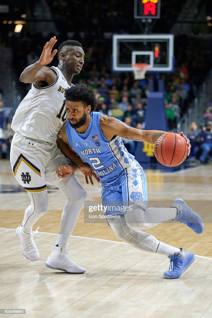 North Carolina Tar Heels guard Joel Berry II (2) dribbles the basketball past Notre Dame Fighting Irish guard TJ Gibbs (10) during the college basketball game between the North Carolina Tar Heels and the Notre Dame Fighting Irish on January 13, 2018, at the Purcell Pavilion in South Bend, IN. The North Carolina Tar Heels defeated the Notre Dame Fighting Irish by the score of 69 to 68.