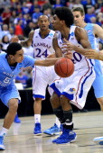 North Carolina Tar Heels guard Marcus Paige steels the ball away from Kansas Jayhawks forward Kevin Young during firsthalf action in the third round...