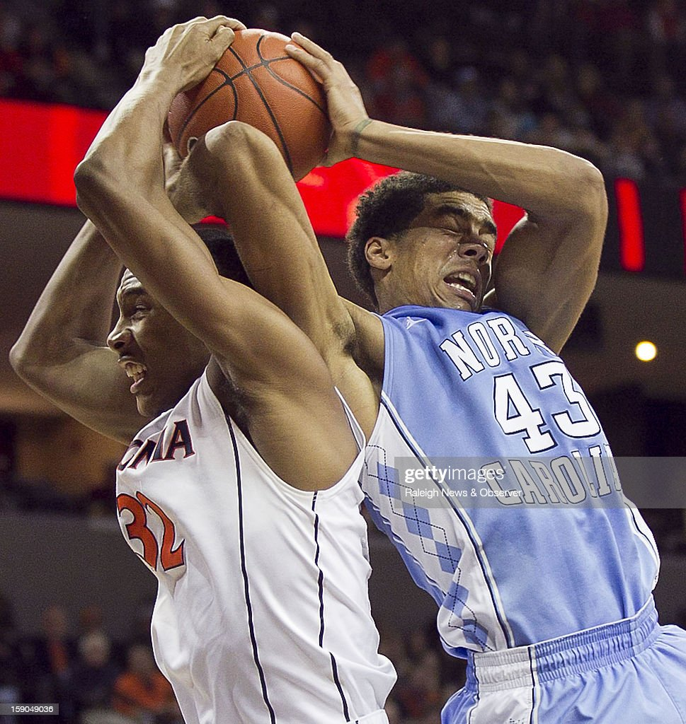 North Carolina Tar Heels' James Michael McAdoo (43) battles for an offensive rebound with Virginia Cavaliers' Darion Atkins (32) during the second half at John Paul Jones Arena on Sunday, January 6, 2013, in Charlottesville, Virginia. The University of Virginia defeated the University of North Carolina, 61-52.