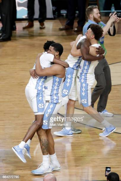 North Carolina Tar Heels palyers embrace and after time expired during the 2017 NCAA Men's Final Four National Championship game against the Gonzaga...