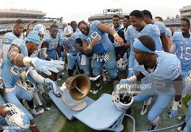 North Carolina Tar Heels players celebrate with the Victory Bell aftera win against the Duke Blue Devils at Kenan Stadium on November 7 2015 in...