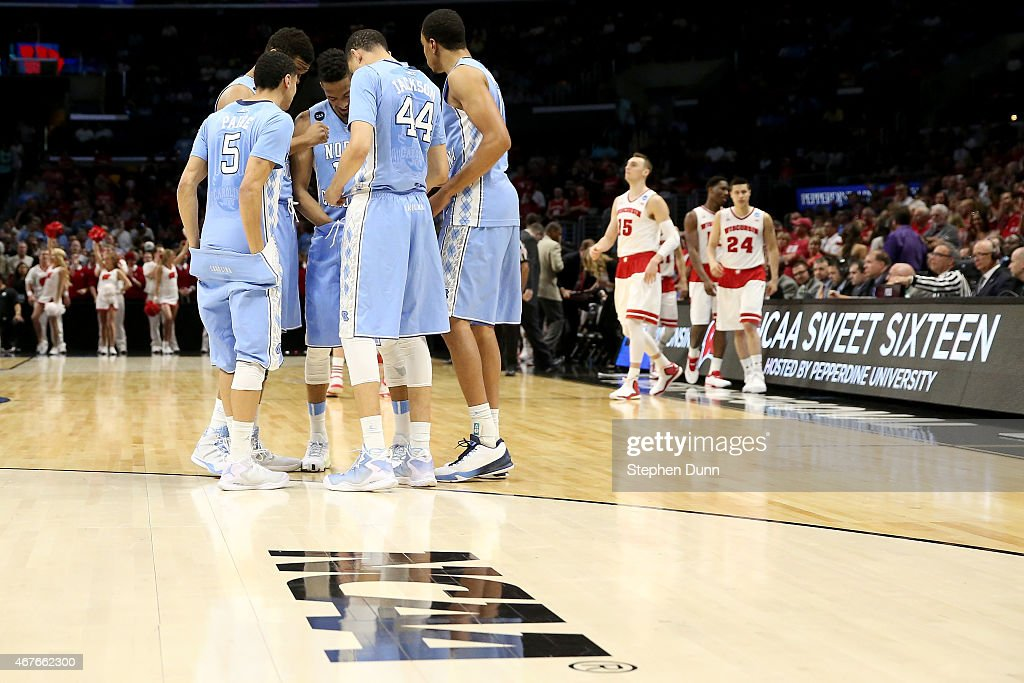 North Carolina Tar Heels players huddle before taking on the Wisconsin Badgers during the West Regional Semifinal of the 2015 NCAA Men's Basketball...