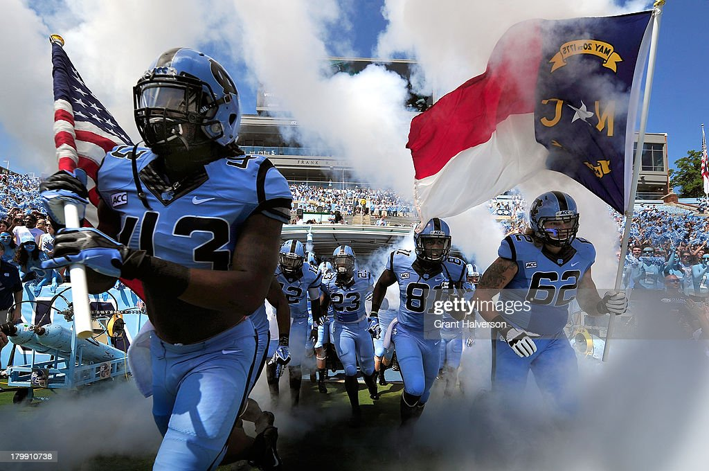 North Carolina Tar Heels players take the field for a game against the Middle Tennessee State Blue Raiders at Kenan Stadium on September 7, 2013 in Chapel Hill, North Carolina.