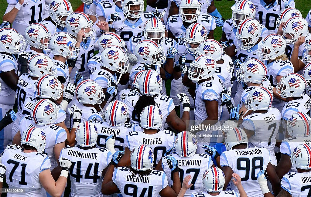 North Carolina Tar Heels players wear patriot helmets with an American flag theme during a Military Appreciation Day game against the East Carolina Pirates at Kenan Stadium on September 28, 2013 in Chapel Hill, North Carolina.
