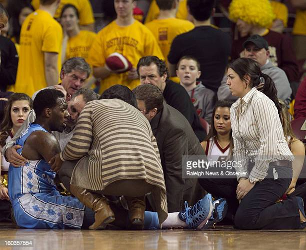 North Carolina trainer Chris Hirth and Boston College EMS attend to UNC's PJ Hairston after he suffered a concussion in the first half of play...