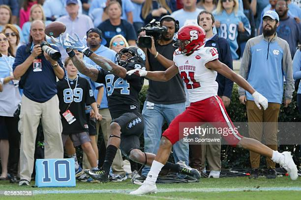 North Carolina wide receiver Bug Howard misses a pass completion while defended by NC State corner back Nick McCloud during the second half between...