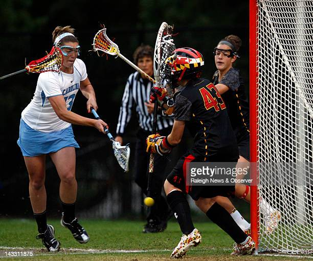 North Carolina's Becky Lynch scores on Maryland's Brittany Dipper in the first half of the ACC Women's Lacrosse Championship game at Koskinen Stadium...