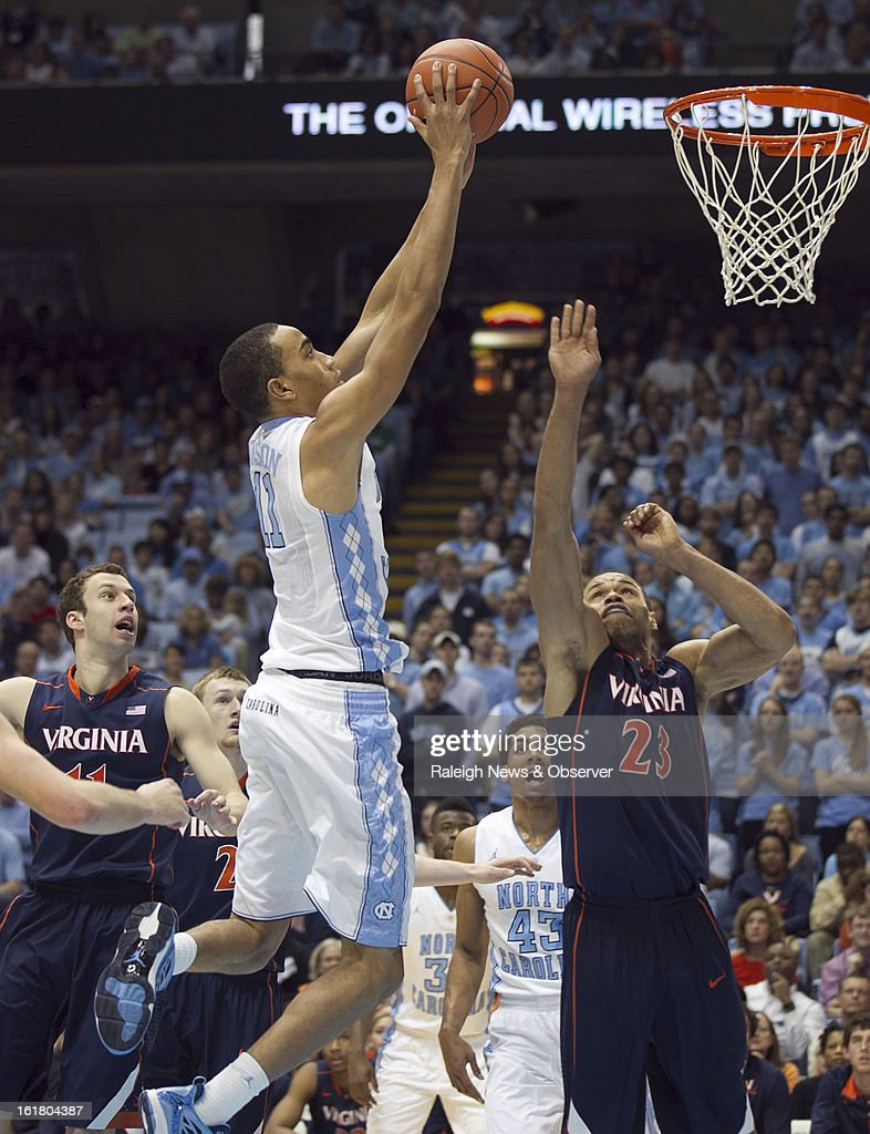 North Carolina's Brice Johnson (11) goes in for a dunk over Virginia's Justin Anderson (23) in the first half at the Smith Center in Chapel Hill, North Carolina, Saturday February 16, 2013. UNC beat Virginia, 93-81.