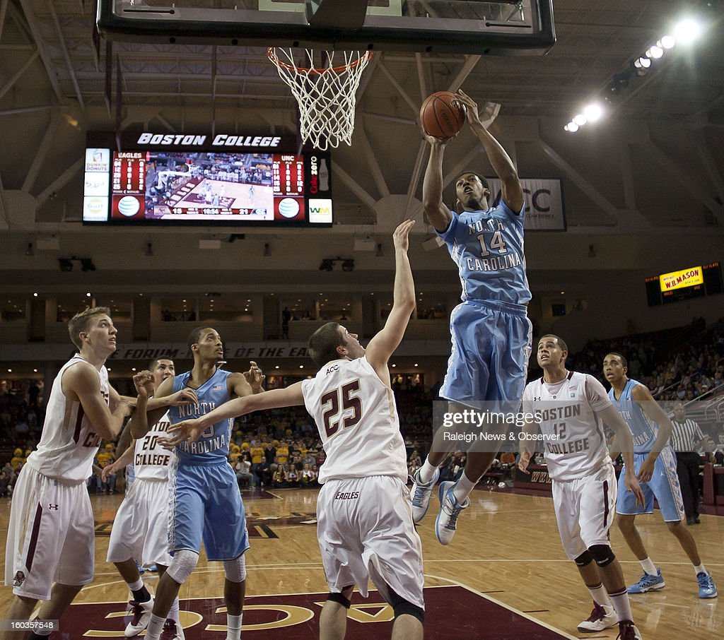 North Carolina's Desmond Hubert (14) puts up a shot over Boston College's Joe Rahon (25) during the first half at the Conte Forum in Chestnut Hill, Massachusetts, Tuesday, January 29, 2013.