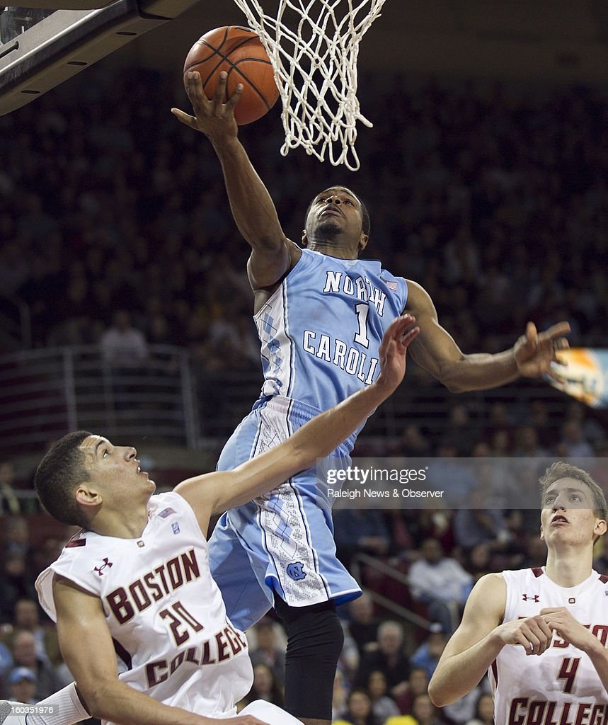North Carolina's Dexter Strickland (1) drives to the basket against Boston College's Lonnie Jackson (20) during the first half at the Conte Forum in Chestnut Hill, Massachusetts, Tuesday, January 29, 2013.