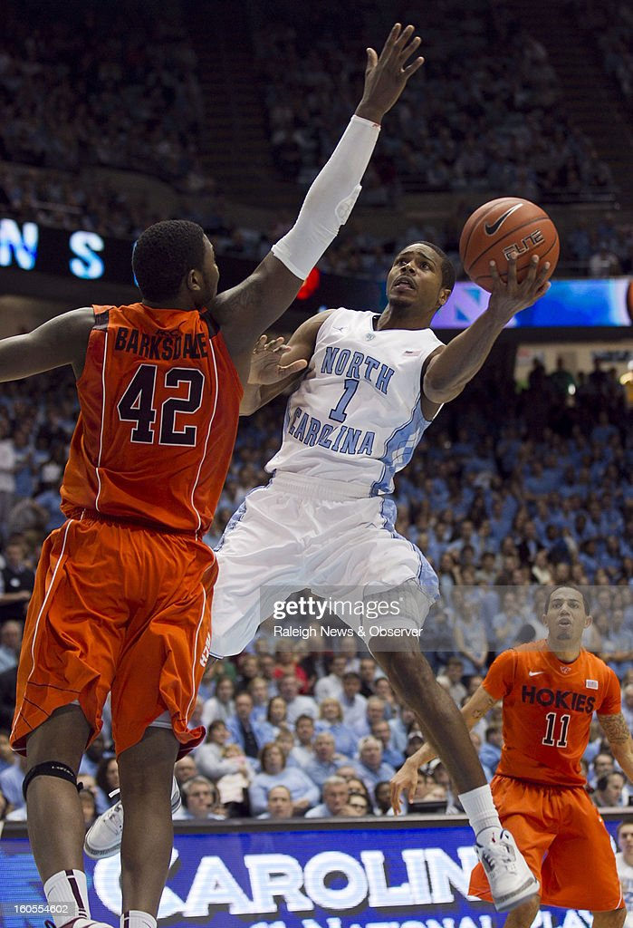 North Carolina's Dexter Strickland (1) drives to the basket against Virginia Tech's C.J. Barksdale (42) during the second half at the Smith Center in Chapel Hill, North Carolina, Saturday, February 2, 2013. North Carolina won in OT, 72-60.