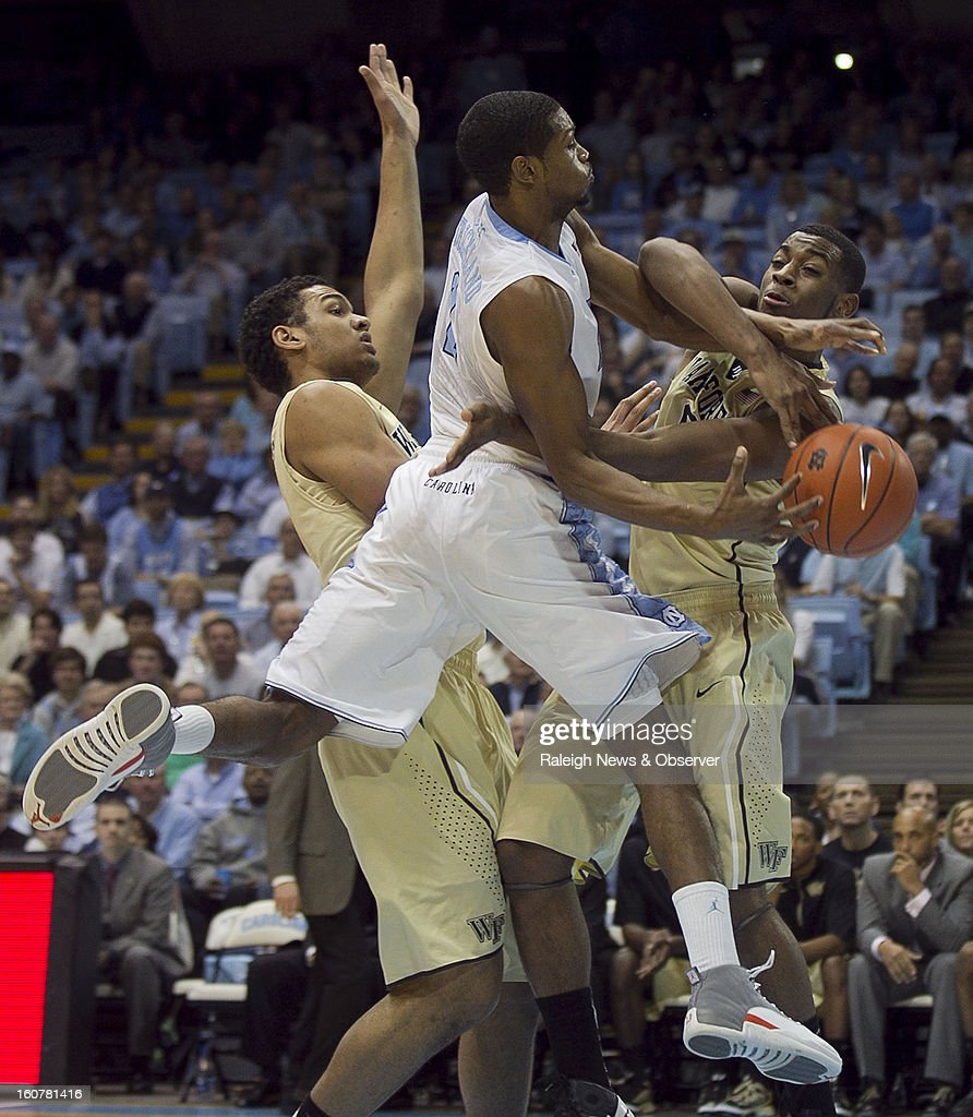 North Carolina's Dexter Strickland (1) gets tangled with Wake Forest's Codi Miller-McIntyre (0) during first-half action at the Smith Center in Chapel Hill, North Carolina, Tuesday, February 5, 2013.