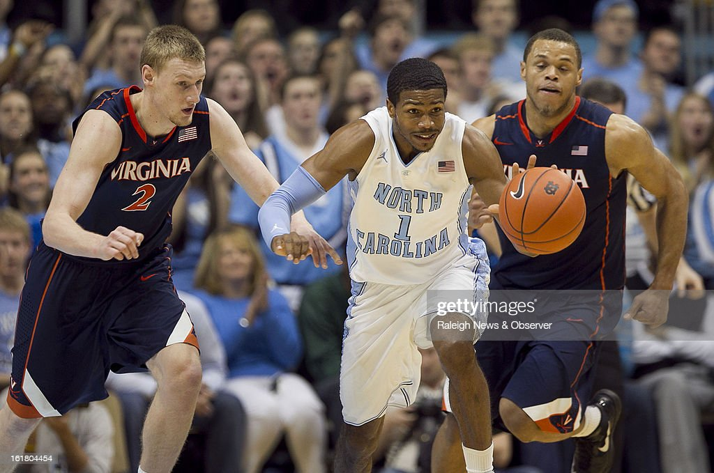 North Carolina's Dexter Strickland (1) leads a fast break after making a steal from Virginia's Paul Jesperson (2) in the first half at the Smith Center in Chapel Hill, North Carolina, Saturday February 16, 2013. UNC beat Virginia, 93-81.