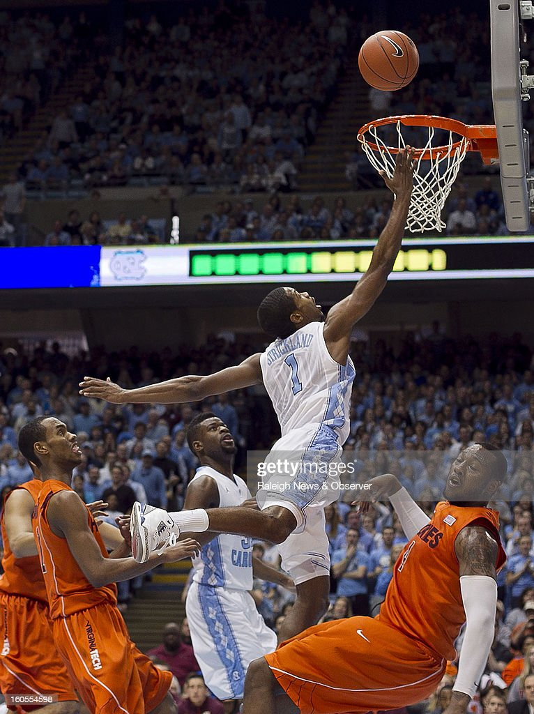North Carolina's Dexter Strickland (1) puts up a shot against Virginia Tech's Cadarian Raines (4) during the first half at the Smith Center in Chapel Hill, North Carolina, Saturday, February 2, 2013. North Carolina won in OT, 72-60.