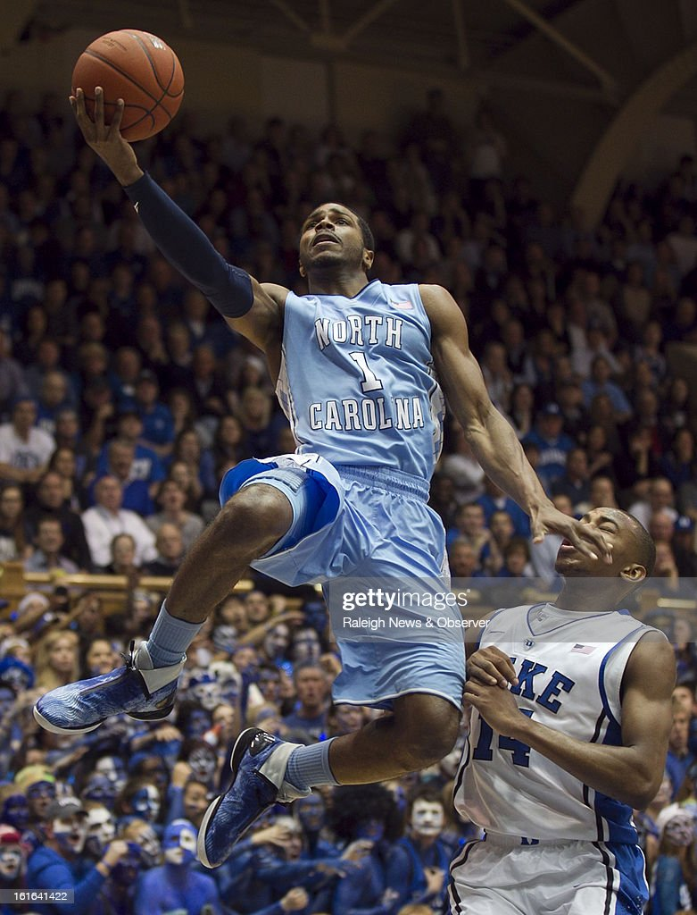 North Carolina's Dexter Strickland (1) shoots over Duke's Rasheed Sulaimon (14) during the first half at Cameron Indoor Stadium in Durham, North Carolina, on Wednesday, February 13, 2013.
