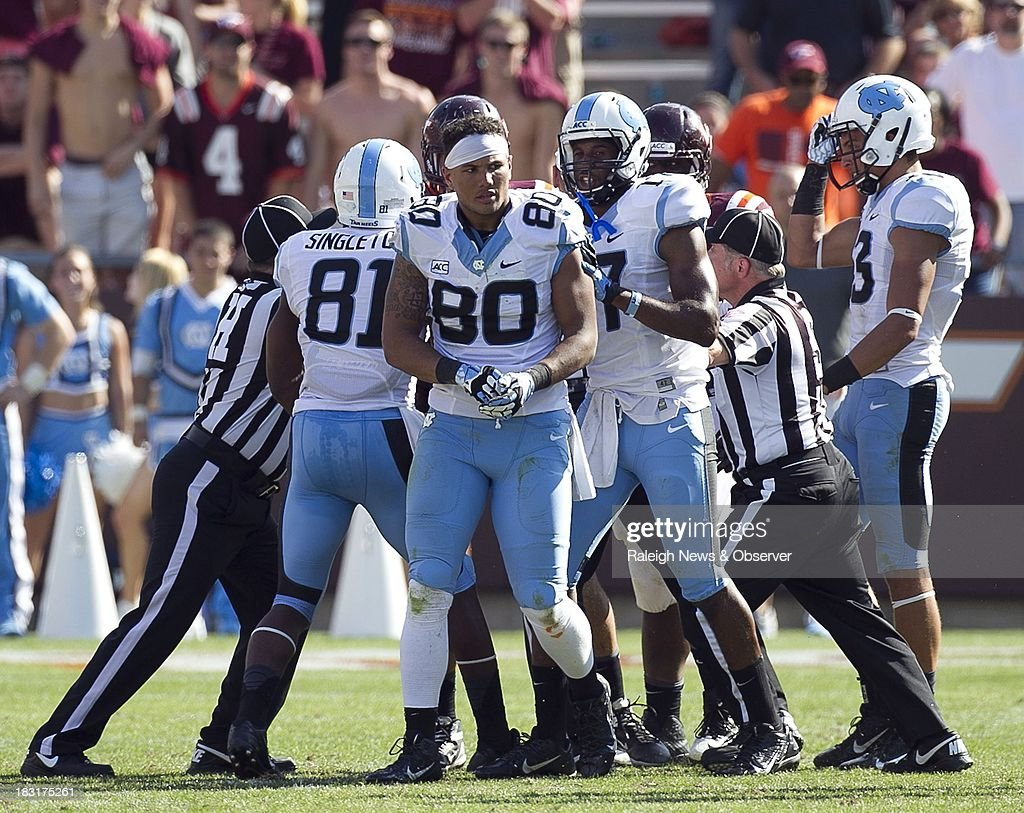 North Carolina's Jack Tabb (80) emerges after a scuffle with a Virginia Tech player on a kickoff return in the fourth quarter at Lane Stadium in Blacksburg, Virginia, Saturday, October 5, 2013. Tabb was disqualified by officials due to a personal foul on the play. Virginia Tech beat UNC, 27-17.