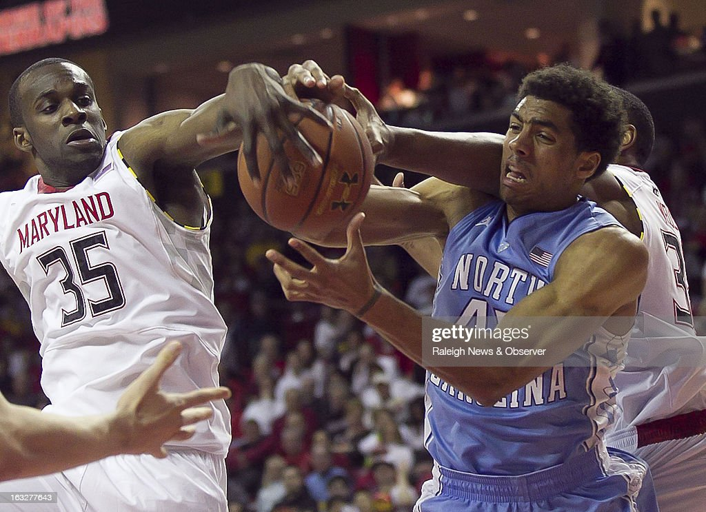 North Carolina's James Michael McAdoo battles for an offensive rebound with Maryland's James Padgett (35) and Dez Wells, right, during the second half on Wednesday, March 6, 2013, at the Comcast Center in College Park, Maryland.