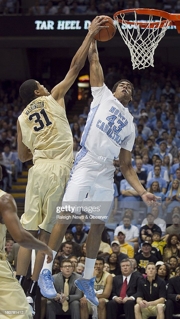 North Carolina's James Michael McAdoo (43) drives to the basket for a dunk and draws a foul against Andre Washington (31) of Wake Forest during first-half action at the Smith Center in Chapel Hill, North Carolina, Tuesday, February 5, 2013.