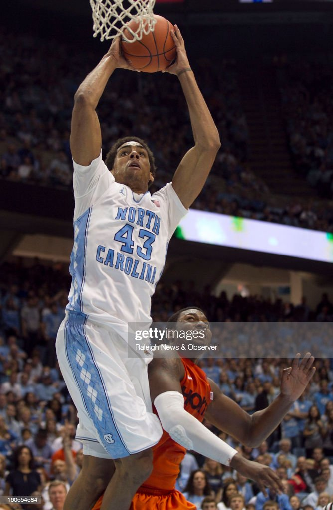 North Carolina's James Michael McAdoo (43) drives to the basket over Virginia Tech's Jarell Eddie at the Smith Center in Chapel Hill, North Carolina, Saturday, February 2, 2013. North Carolina won in OT, 72-60.