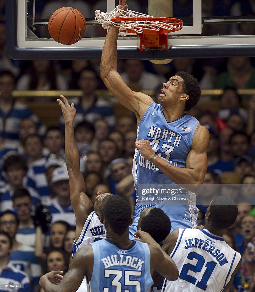 North Carolina's James Michael McAdoo (43) gets his hand caught in the net as he defends a shot by Duke's Rasheed Sulaimon during the first half at Cameron Indoor Stadium in Durham, North Carolina, on Wednesday, February 13, 2013.