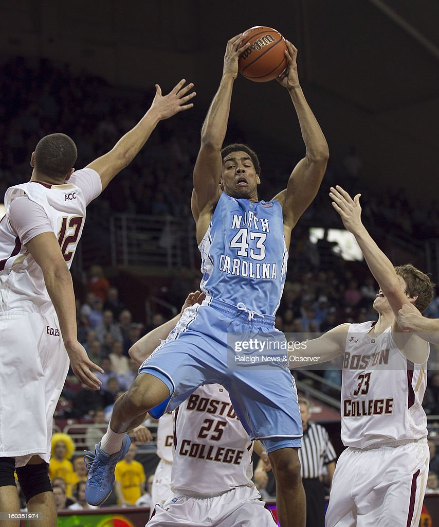North Carolina's James Michael McAdoo (43) pulls down an offensive rebound between Boston College's Ryan Anderson (12) and Patrick Heckmann (33) in the first half at the Conte Forum in Chestnut Hill, Massachusetts, Tuesday, January 29, 2013.