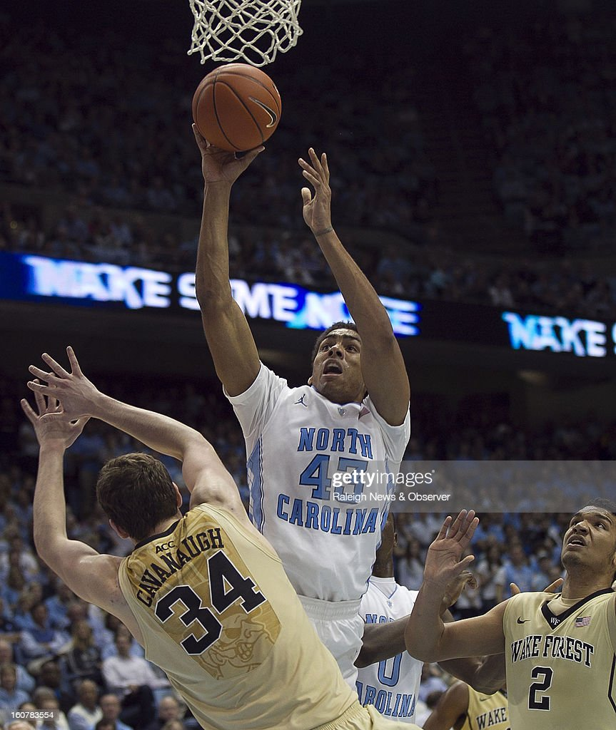 North Carolina's James Michael McAdoo (43) puts up a shot for two of his 20 points against Wake Forest's Tyler Cavanaugh (34) and Devin Thomas (2) during the second half at the Smith Center in Chapel Hill, North Carolina, Tuesday, February 5, 2013.