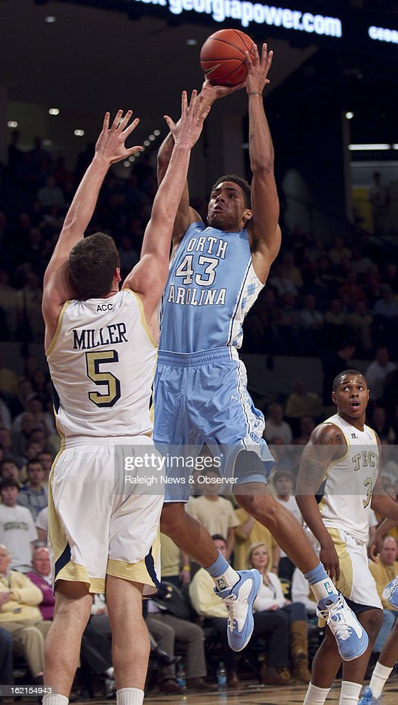 North Carolina's James Michael McAdoo (43) puts up a shot over Georgia Tech's Daniel Miller (5) during the first half on Tuesday, February 19, 2013, at McCamish Center in Atlanta, Georgia.