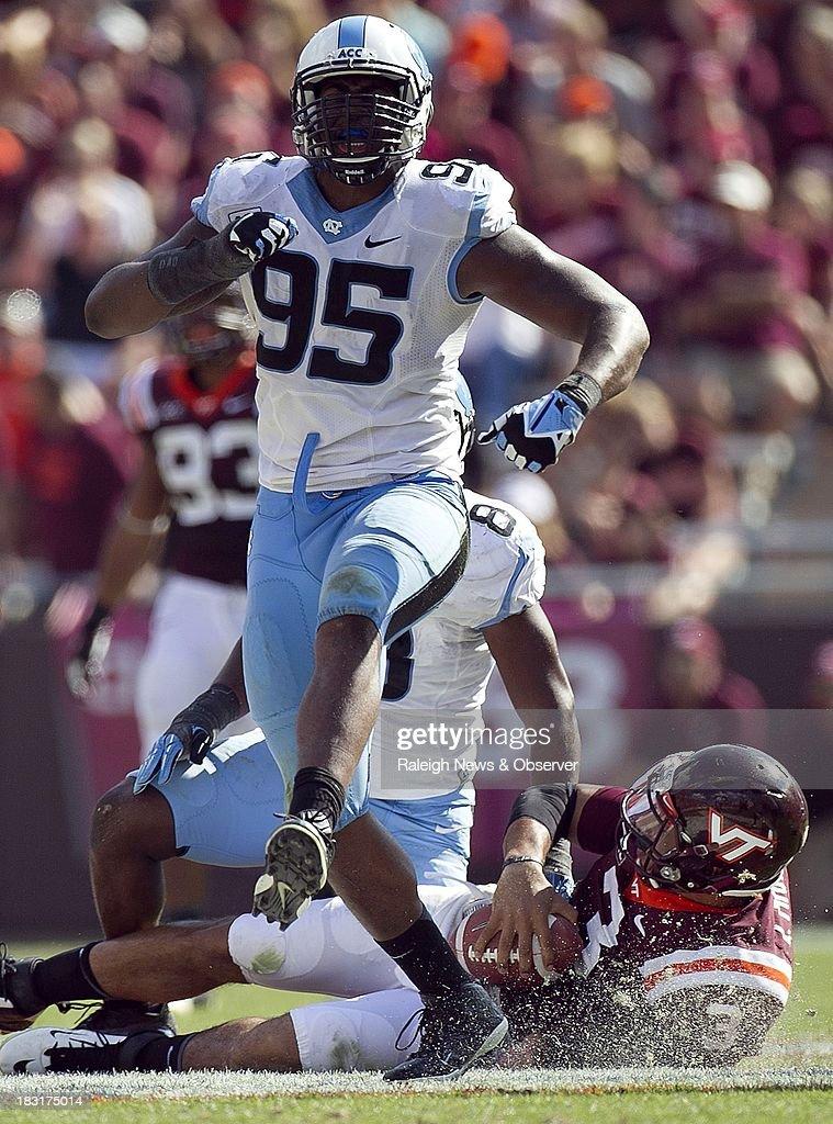 North Carolina's Kareem Martin (95) celebrates after sacking Virginia Tech quarterback Logan Thomas (3) for a 14-yard loss in the fourth quarter at Lane Stadium in Blacksburg, Virginia, Saturday, October 5, 2013.