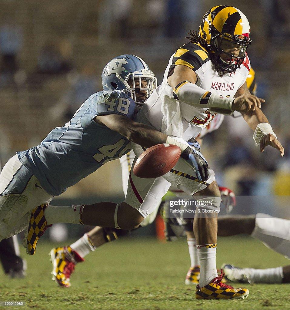 North Carolina's Kevin Reddick (48) forces Maryland quarterback Shawn Petty (31) to fumble the ball in the third quarter on Saturday, November 24, 2012, at Kenen Stadium in Chapel Hill, North Carolina. The host Tar Heels won, 45-38.