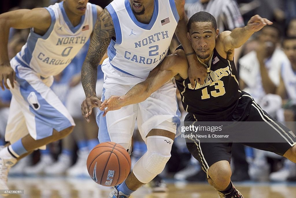 North Carolina's Leslie McDonald (2) makes a steal from Wake Forest's Coron Williams (13) during the first half on Saturday February 22, 2014, at the Smith Center in Chapel Hill, N.C. North Carolina won, 105-72.