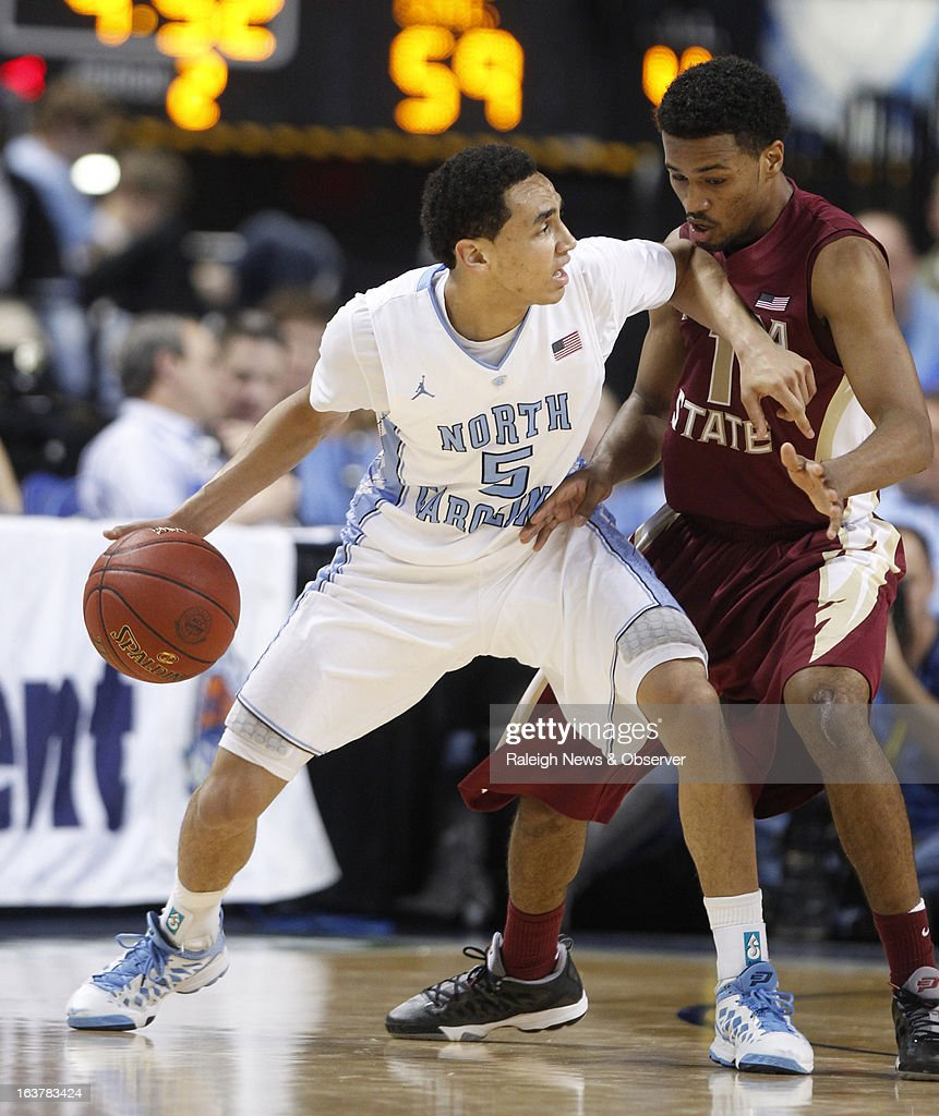 North Carolina's Marcus Paige (5) keeps the ball from Florida State's Devon Bookert (1) during the second half in the ACC Tournament quarterfinals at the Greensboro Coliseum in Greensboro, North Carolina, on Friday, March 15, 2013.