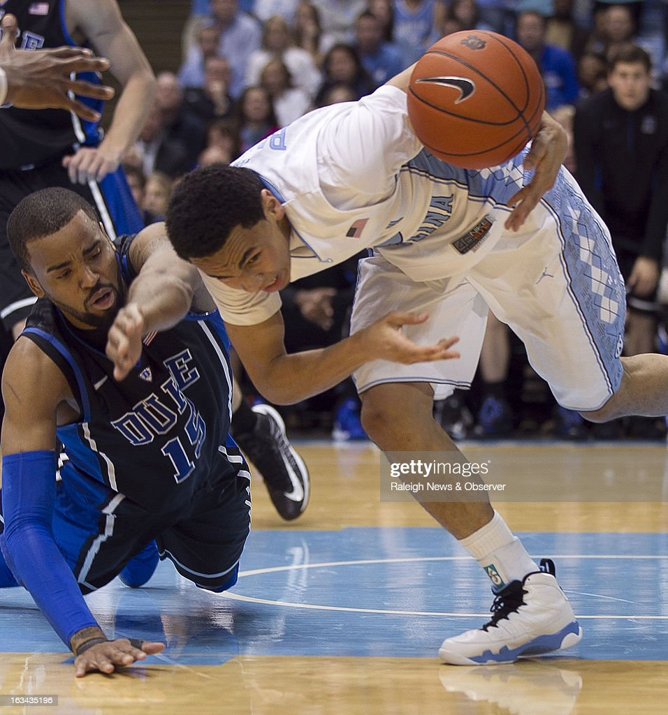 North Carolina's Marcus Paige (5) looses control of the ball as Duke's Josh Hairston (15) pressures during the second half on Saturday, March 9, 2013, at the Smith Center in Chapel Hill, North Carolina. Duke topped the Tar Heels, 69-53.