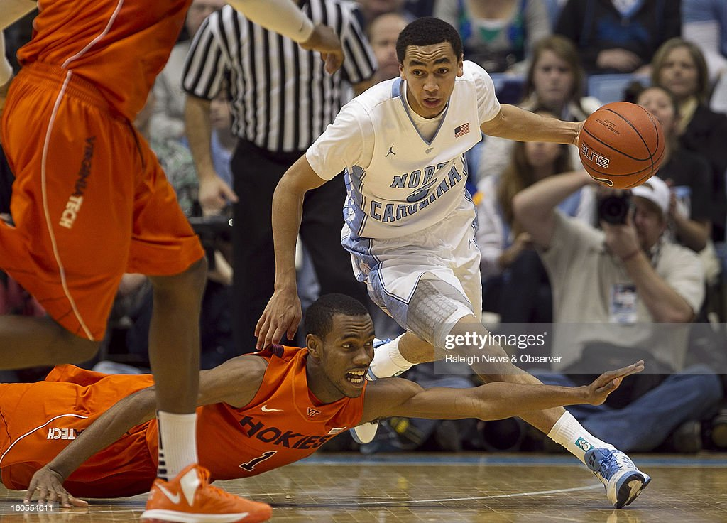 North Carolina's Marcus Paige makes a steal from Virginia Tech's Robert Brown (1) during the second half at the Smith Center in Chapel Hill, North Carolina, Saturday, February 2, 2013. North Carolina won in OT, 72-60.