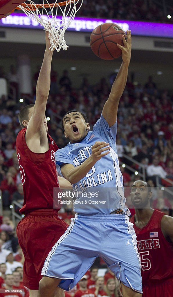 North Carolina's Marcus Paige (5) puts up a shot against North Carolina State's Scott Wood (15) during the second half on Saturday, January 26, 2013, at the PNC Arena in Raleigh, North Carolina. The host Wolfpack won, 91-83.