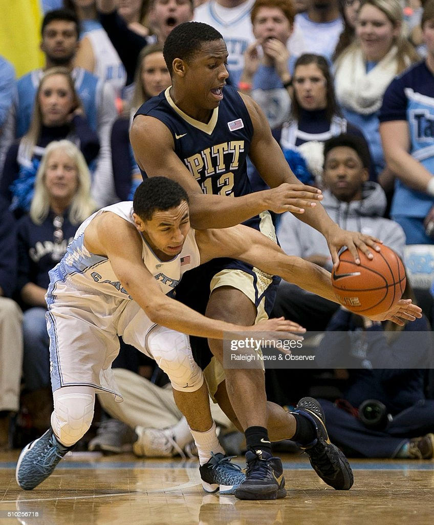North Carolina's Marcus Paige (5) tries for a steal from Pitt's Chris Jones (12) during the first half on Sunday, Feb. 14, 2016, at the Smith Center in Chapel Hill, N.C.