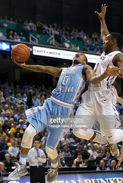 North Carolina's Nate Britt drives to the basket against UNCG's Diante Baldwin during the first half on Tuesday Dec 16 at the Greensboro Coliseum in...