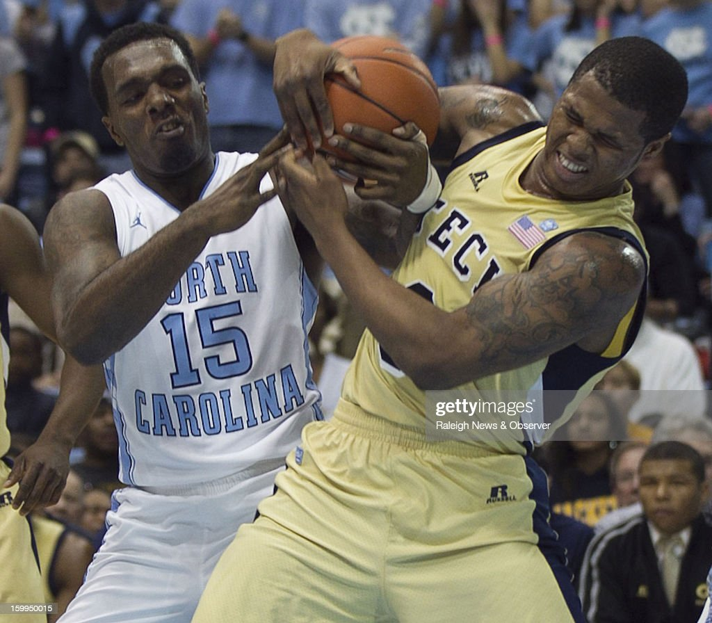 North Carolina's P.J. Hairston (15) battles for a loose ball with Georgia Tech's Marcus Georges-Hunt (3) during the first half on Wednesday, January 23, 2013, at the Smith Center in Chapel Hill, North Carolina.