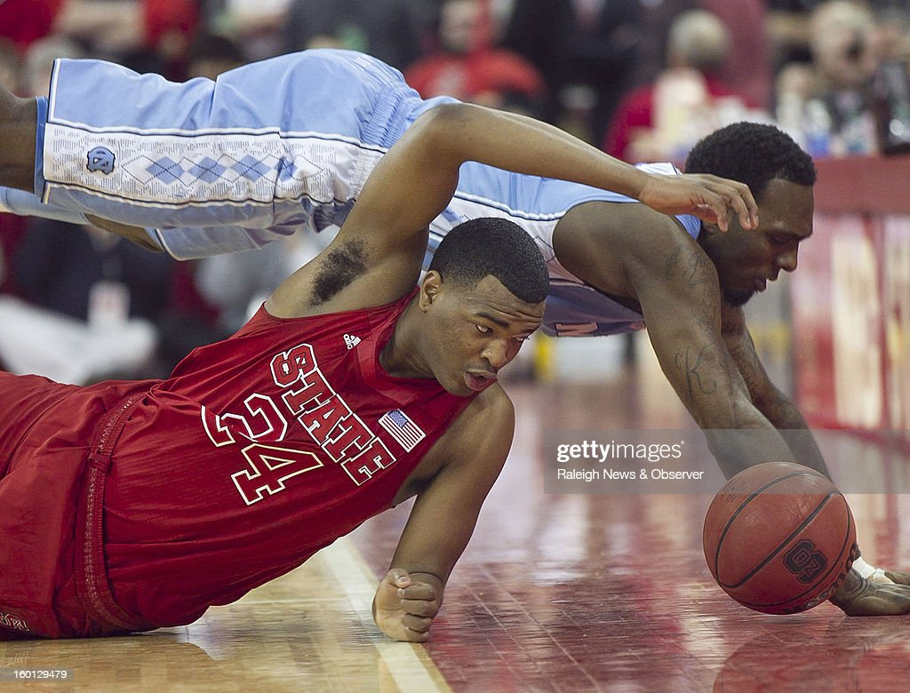 North Carolina's P.J. Hairston dives over North Carolina State's T.J. Warren (24) for a loose ball during the second half on Saturday, January 26, 2013, at the PNC Arena in Raleigh, North Carolina. The host Wolfpack won, 91-83.
