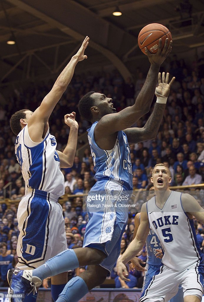 North Carolina's P.J. Hairston (15) drives to the basket for two of his 23 points between Duke's Seth Curry (30) and Mason Plumlee (5) in the second half at Cameron Indoor Stadium in Durham, North Carolina, on Wednesday, February 13, 2013. Duke edged North Carolina, 73-68.