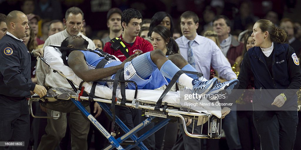 North Carolina's P.J. Hairston (15) is taken off the court on a stretcher after falling in the first half of a men's college basketball game against Boston College at the Conte Forum in Chestnut Hill, Massachusetts, Tuesday, January 29, 2013.