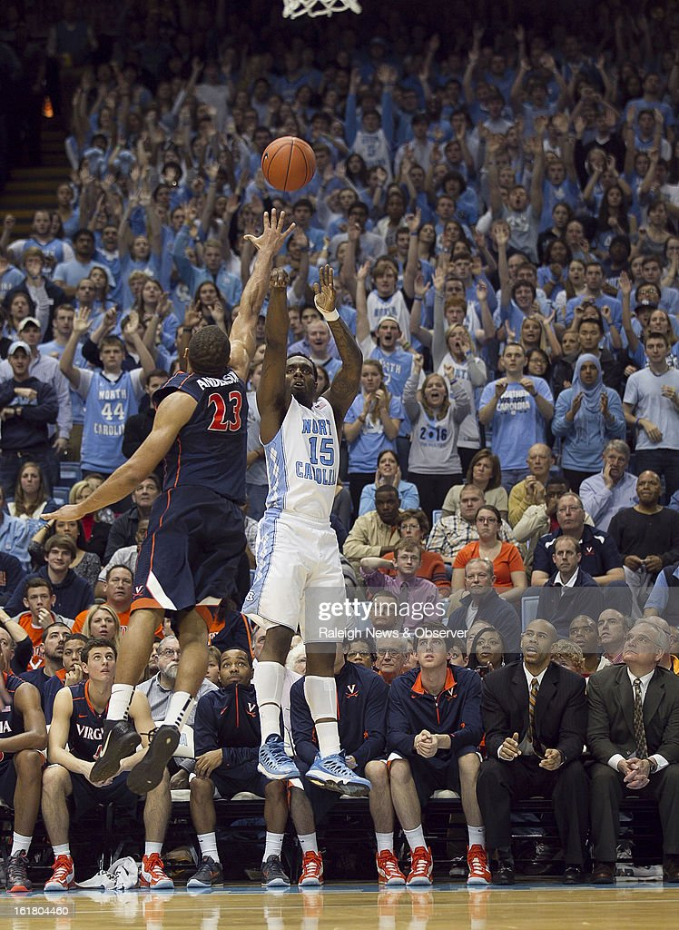 North Carolina's P.J. Hairston (15) launches a three-point shot over Virginia's Justin Anderson (23) in the first half at the Smith Center in Chapel Hill, North Carolina, Saturday February 16, 2013. UNC beat Virginia, 93-81.