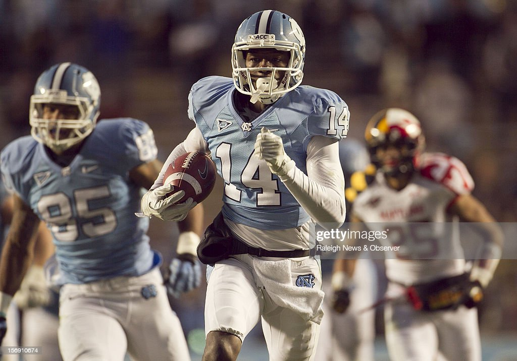 North Carolina's Quinshad Davis (14) races ahead of the Maryland defense on a 50-yard pass completion from quarterback Bryn Renner for a third-quarter touchdown on Saturday, November 24, 2012, at Kenen Stadium in Chapel Hill, North Carolina. The host Tar Heels won, 45-38.