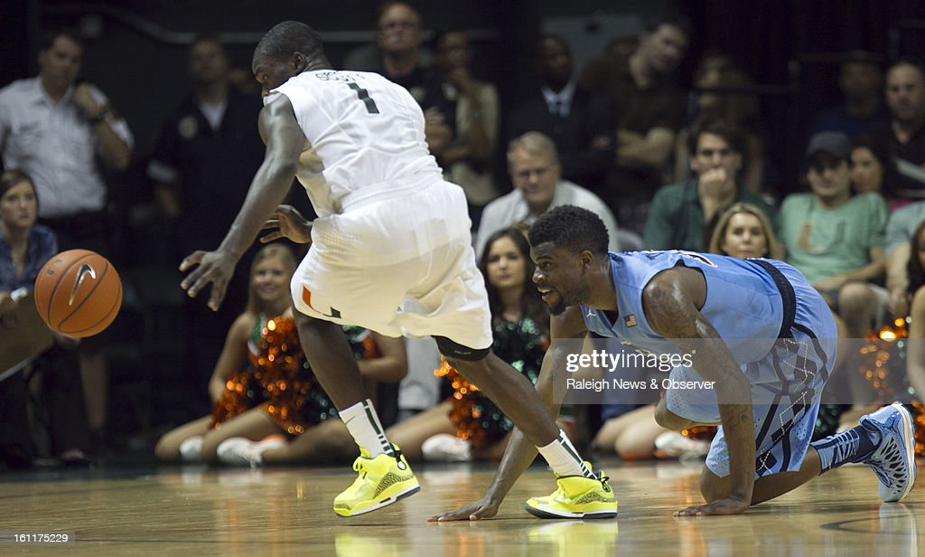 North Carolina's Reggie Bullock, right, turns the ball over to Miami's Durand Scott (1) during the second half on Saturday, February 9, 2013, at the BankUnited Center in Coral Gables, Florida. Miami toppled the Tar Heels, 87-61.