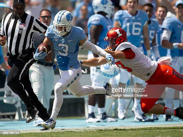North Carolina's Ryan Switzer returns a punt 71 yards before being knocked out of bounds by Illinois kicker Ryan Frain in the second quarter on...