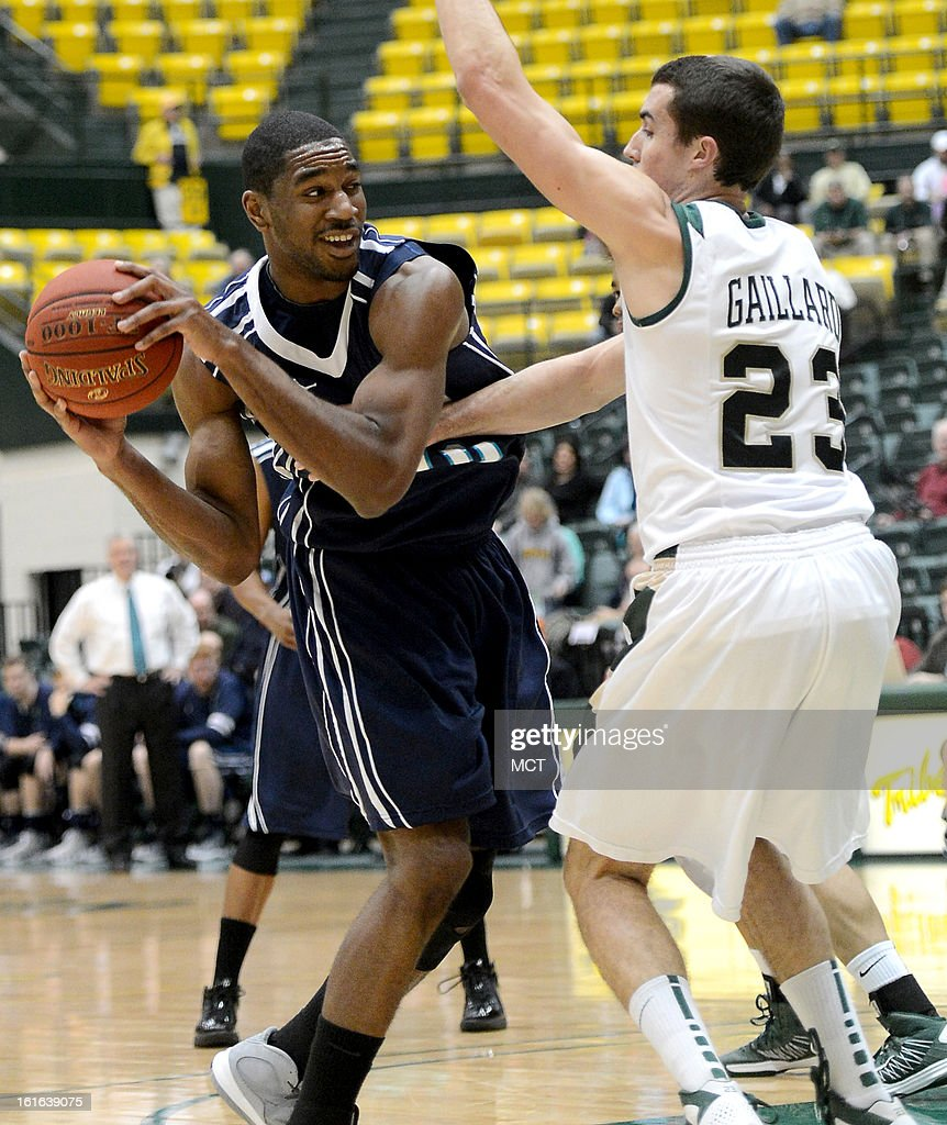 North Carolina-Wilmington forward Cedrick Williams (40) looks to make a pass against the tight defense of William & Mary forward Kyle Gaillard (23) in the first half at Kaplan Arena in Williamsburg, Virginia, Wednesday, February 13, 2013. William & Mary defeated UNCW, 92-86.